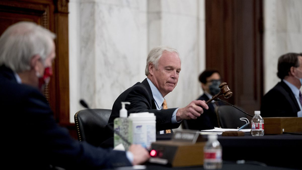 Chairman Sen. Ron Johnson, R-Wis., gavels a Senate Homeland Security and Governmental Affairs committee meeting to a close on Capitol Hill in Washington, Wednesday, May 20, 2020, after voting to issue a subpoena to Blue Star Strategies. (AP Photo/Andrew Harnik)