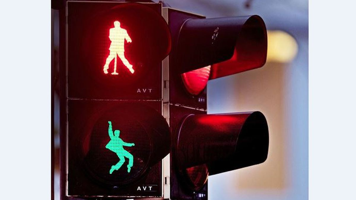 Walking figures depicting late US rock and roll legend Elvis Presley appear on a traffic light...