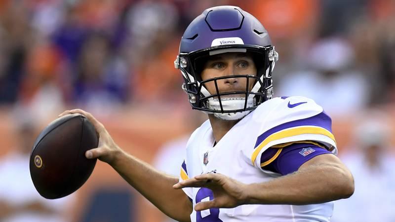 Minnesota Vikings quarterback Kirk Cousins looks to throw a pass against the Denver Broncos...
