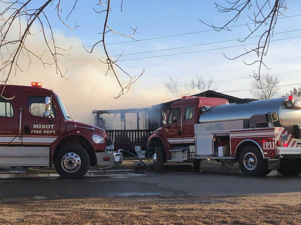 Fire mostly knocked down at mobile home at Jefferson Mobile Home Park in Minot Sunday...