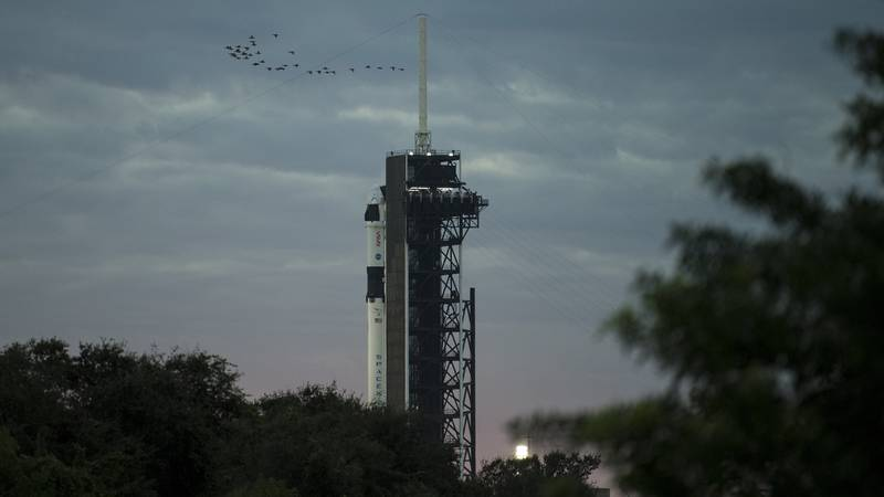A SpaceX Falcon 9 rocket with the company's Crew Dragon spacecraft onboard is seen on the...