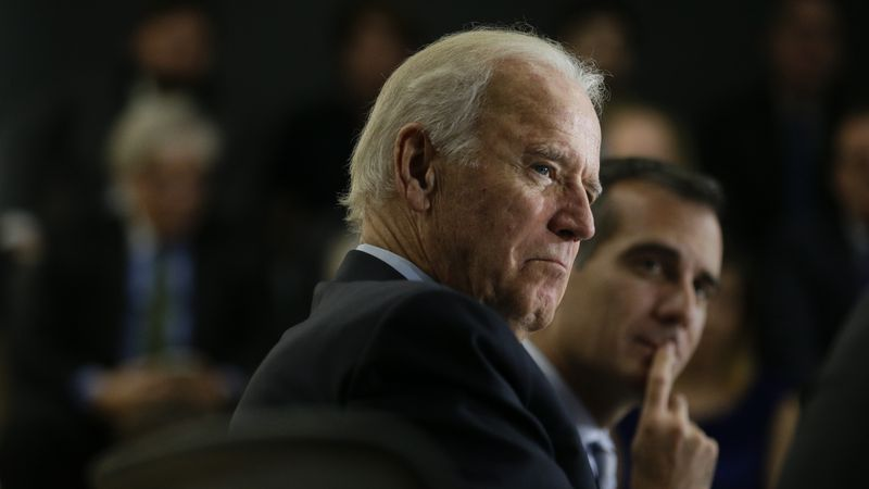 Vice President Joe Biden, joined by Los Angeles Mayor Eric Garcetti, background right,...