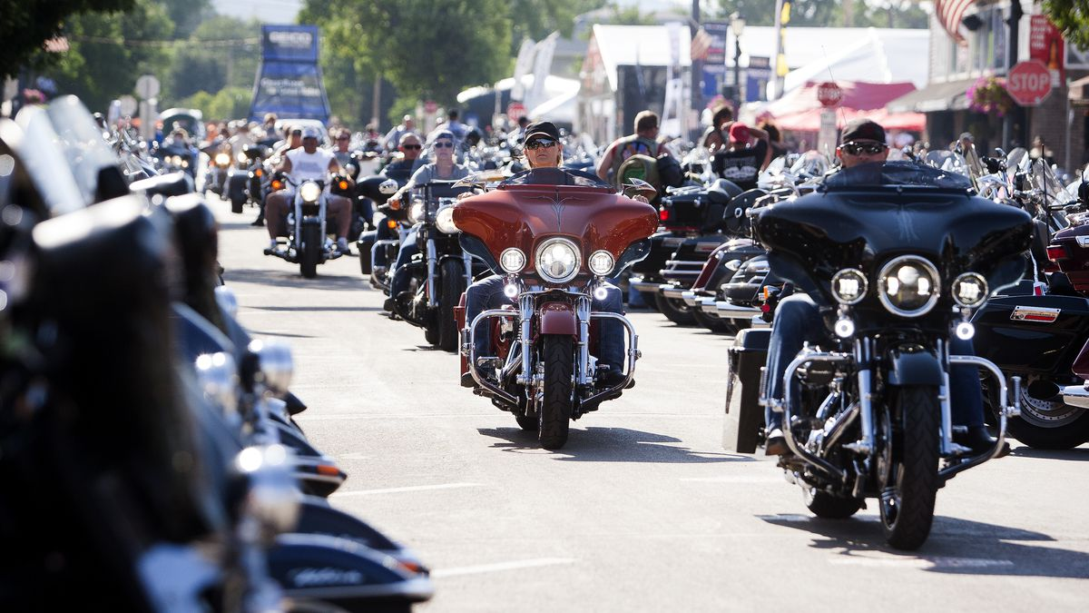 In this Aug. 5, 2016 file photo, bikers ride down Main Street in downtown Sturgis, S.D., before the 76th Sturgis motorcycle rally officially begins.  South Dakota, which has seen an uptick in coronavirus infections in recent weeks, is bracing to host hundreds of thousands of bikers for the 80th edition of the Sturgis Motorcycle Rally. Over a quarter of a million people are expected to rumble through western South Dakota.