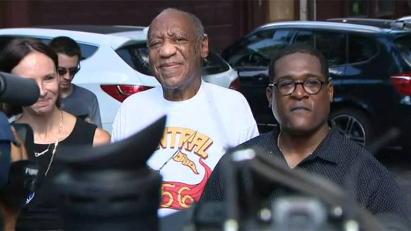 Bill Cosby, second from right, is being sued by a woman who alleges a sexual assault in 1990.