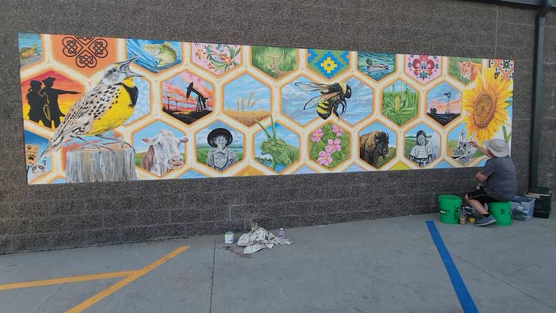 The murals are North Dakota themed, but Paul Noot says they're different than any he's ever...