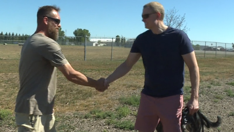 Brian May and Josh Ross shaking hands