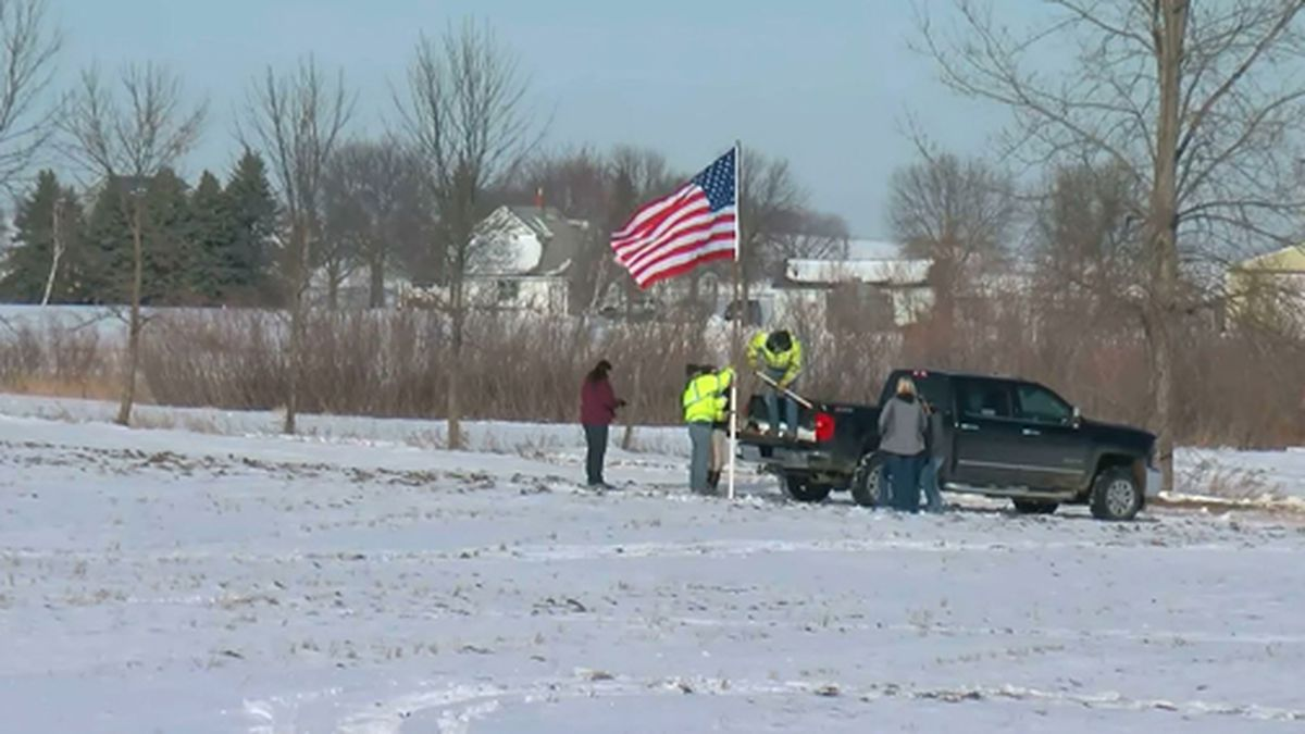 An American flag was placed at the site of a military helicopter crash that killed three in Minnesota. (Source: WCCO/CNN)