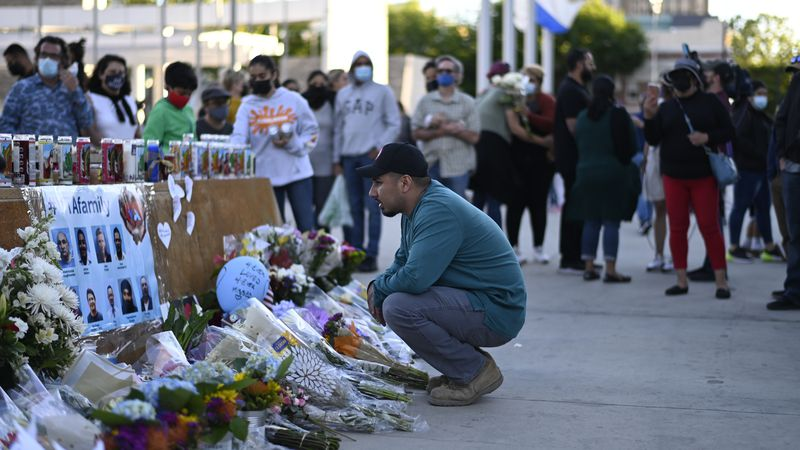 A man looks at a memorial at City Hall in San Jose, Calif., Thursday, May 27, 2021, in honor of...