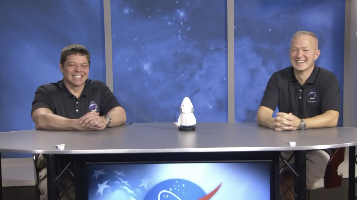 In this frame grab from NASA TV video, astronauts Bob Behnken, left, and Doug Hurley laugh...