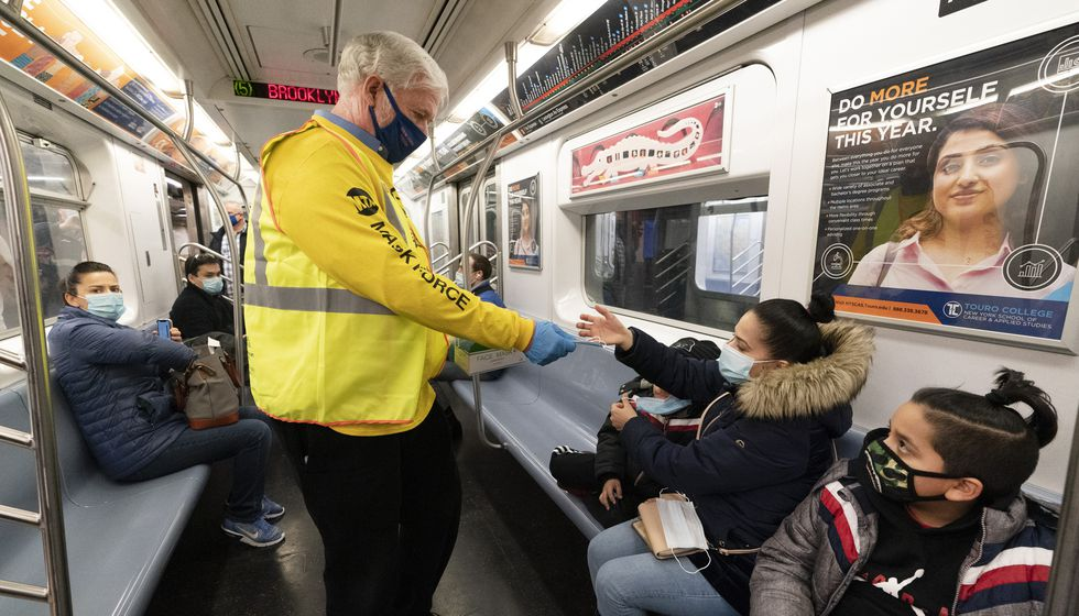 Patrick Foye, Chairman and CEO of the Metropolitan Transportation Authority, hands out face...
