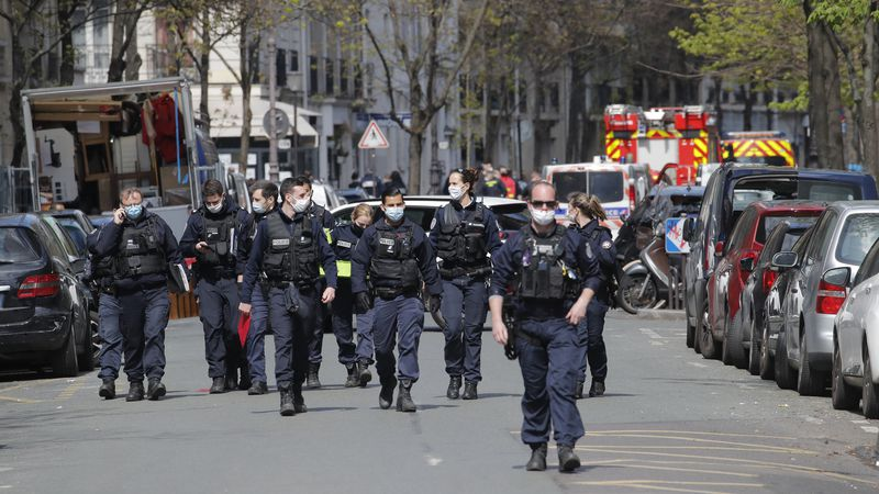 Police officers leave the scene after a shooting Monday, April 12, 2021 in Paris. A gunman has...