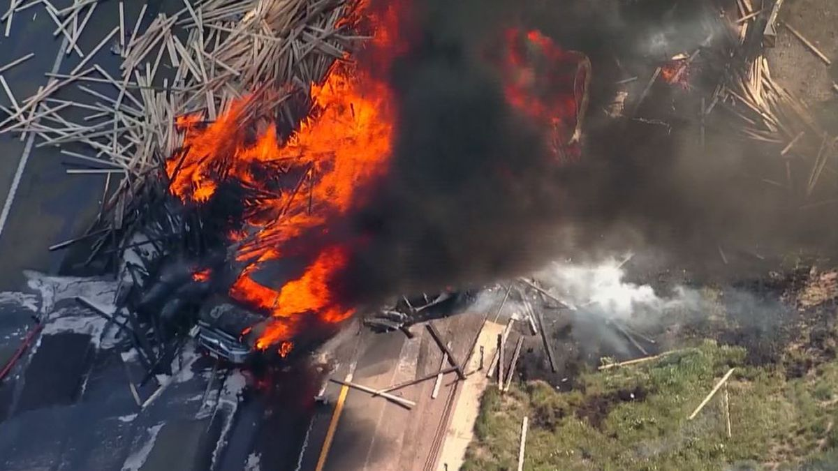 Three semi-trucks and a dozen cars collided on Interstate 70 in Colorado on Thursday, sparking a massive blaze. (Source: KDVR/CNN)