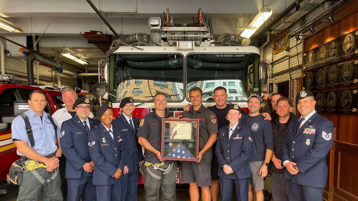 Flag presented by airmen of Minot Air Force Base to Ladder Company 3 in New York City