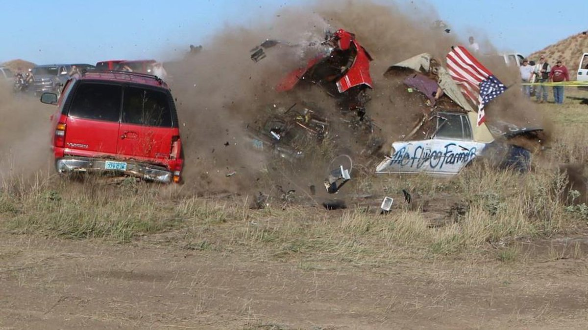 Daredevil John Smith, known as the Flying Farmer, crashes his Chevrolet Caprice while...