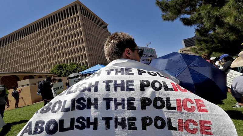 Protesters rally Wednesday, June 3, 2020, in Phoenix, demanding that the Phoenix City Council...