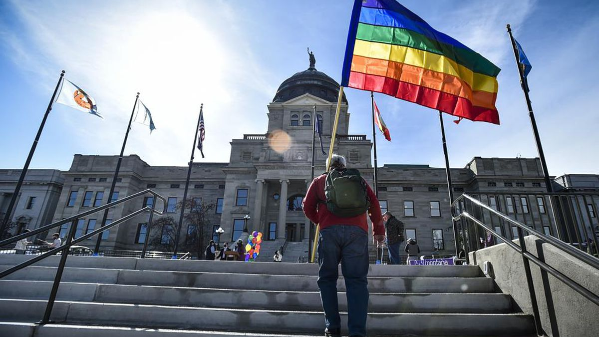 FILE - In this March 15, 2021, file photo demonstrators gather on the steps of the Montana...