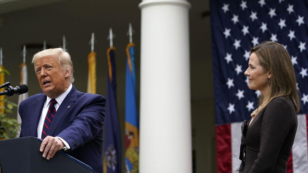 Judge Amy Coney Barrett listens as President Donald Trump announces Barrett as his nominee to...