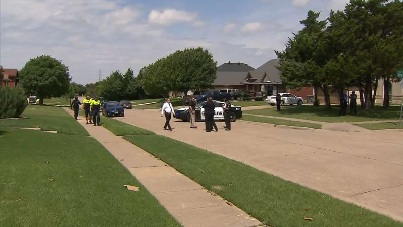 Police said a suspect is in custody after a child was found dead on the street in a Dallas,...