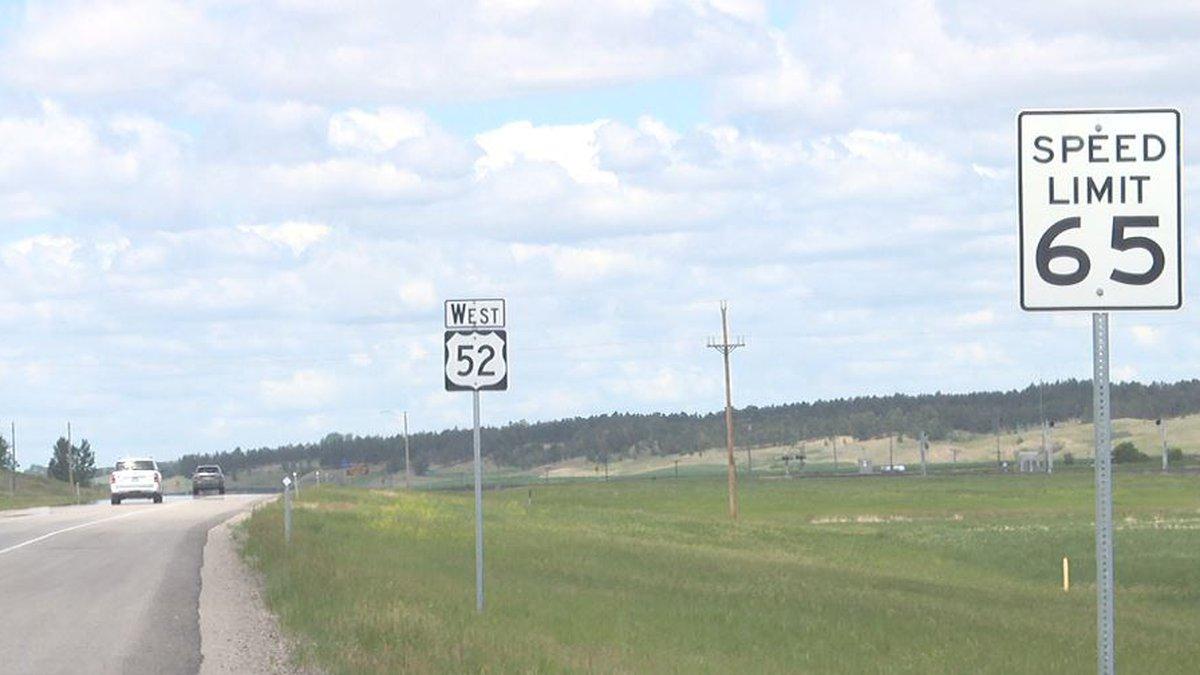 Highway 52 road sign