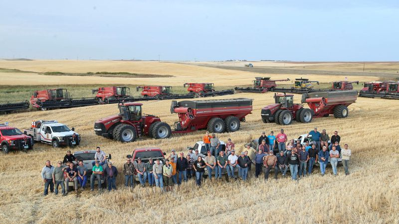 Neighbors, friends, and family brought 11 combines, 6 grain carts, and 15 semis to get Lane...