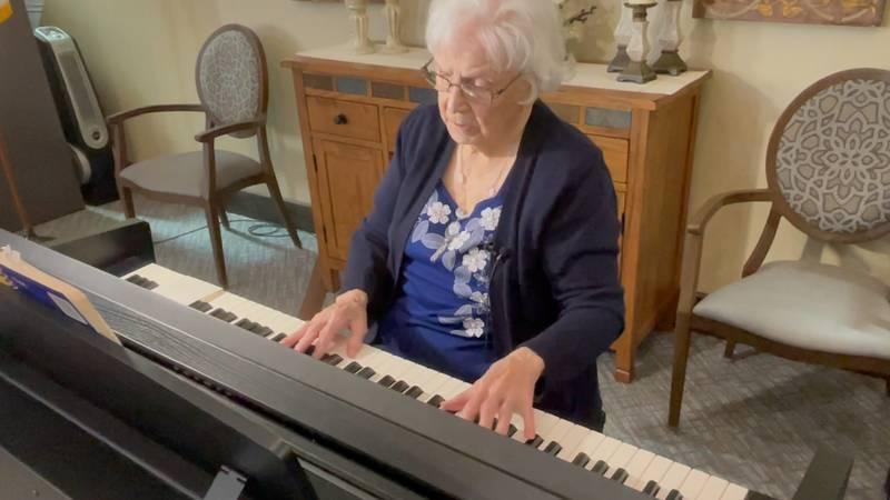 Hulda Erdman at her piano