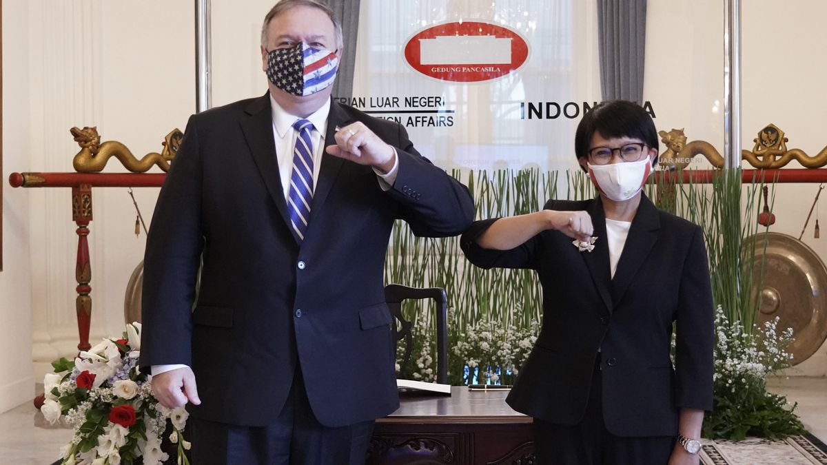 In this photo released by Indonesian Ministry of Foreign Affairs, U.S. Secretary of State Mike...