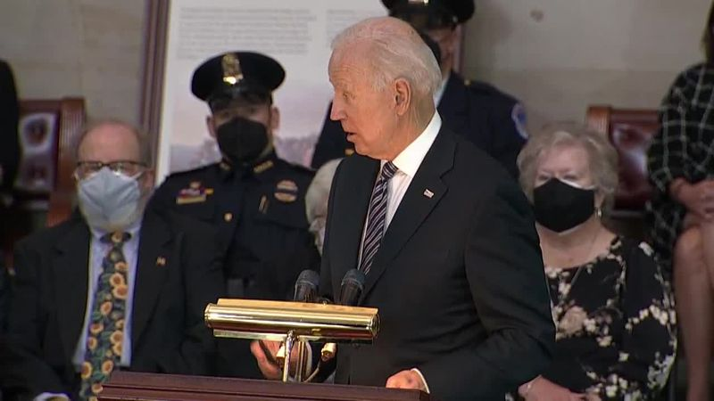 President Joe Biden pays tribute to William Evans, a fallen Capitol Police officer, during a...