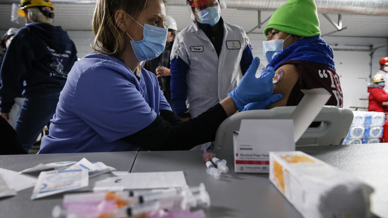 IMAGE DISTRIBUTED FOR TYSON FOODS - Tyson Foods team members receive Covid-19 vaccines from...