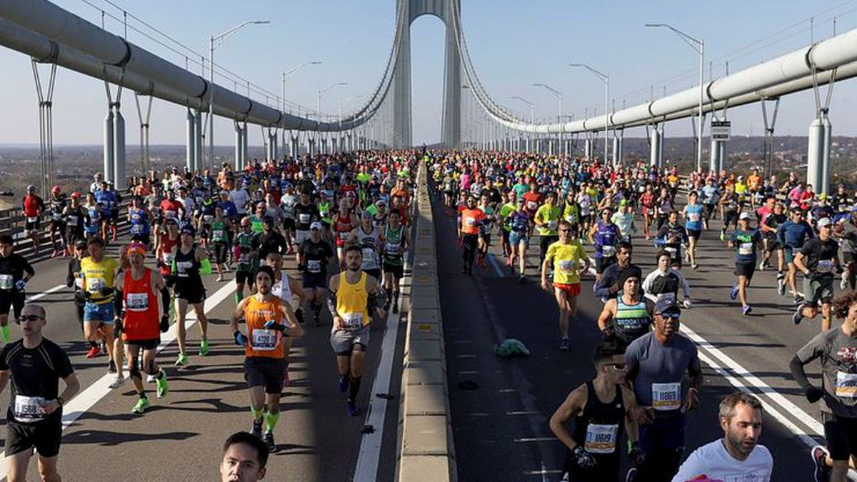 Runners make their way across the Verrazzano-Narrows Bridge during the start of the New York City Marathon, Sunday, Nov. 3, 2019, in New York. The New York City Marathon scheduled for Nov. 1, 2020, has been canceled because of the coronavirus pandemic. (Source: AP Photo/Julius Motal)