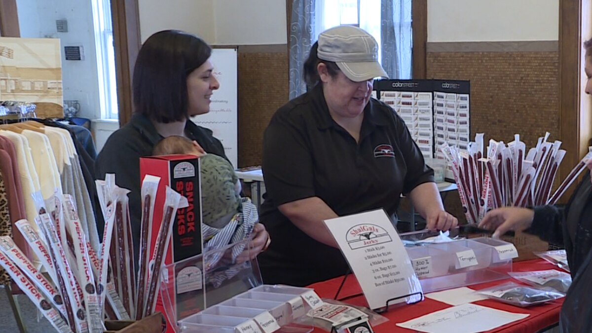 Leia Shalhoob and her daughter Maggie Kopp are helping customers at a Mother's Day small...