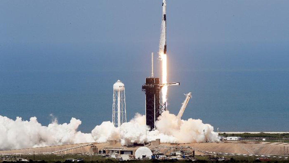 A SpaceX Falcon 9, with NASA astronauts Doug Hurley and Bob Behnken in the Dragon crew capsule,...