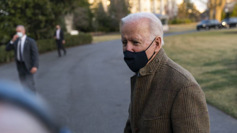 FILE - President Joe Biden speaks to the gathered media members upon arrival at the White House...