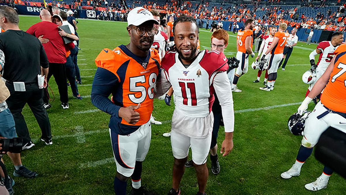FILE - In this Aug. 29, 2019, file photo, Denver Broncos outside linebacker Von Miller (58) greets Arizona Cardinals wide receiver Larry Fitzgerald (11) after an NFL preseason football game in Denver. The NFL will cut its preseason in half and push back the start of exhibition play so teams have more time to train following an all virtual offseason made necessary by the coronavirus pandemic, a person with knowledge of the decision told The Associated Press.
