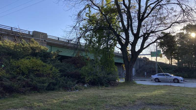 A vehicle passes beneath state Route 37, in Cranston, R.I., early Wednesday, Oct. 20, 2021....